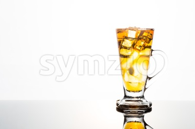 Refreshing ice cold tea in transparent glass Stock Photo