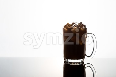 Mysterious ice cold drink in silhouette glass mug Stock Photo