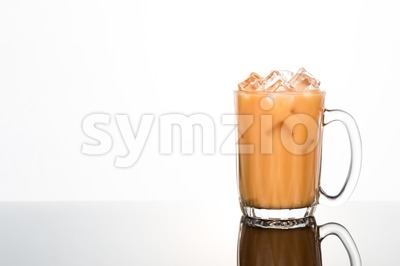 Refreshing ice cold tea with milk in transparent glass Stock Photo