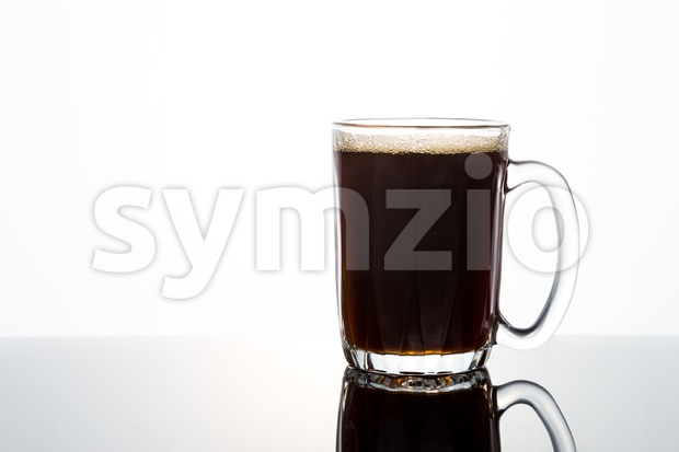 Aromatic hot black coffee in transparent glass Stock Photo