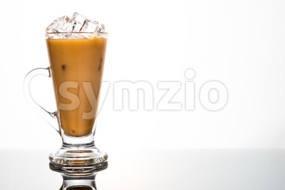 Refreshing ice cold coffee with milk in transparent glass Stock Photo