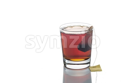 Freshly brewed hot tea with teabag in transparent glass Stock Photo
