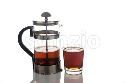 Freshly brewed hot tea in transparent glass with portafilter Stock Photo