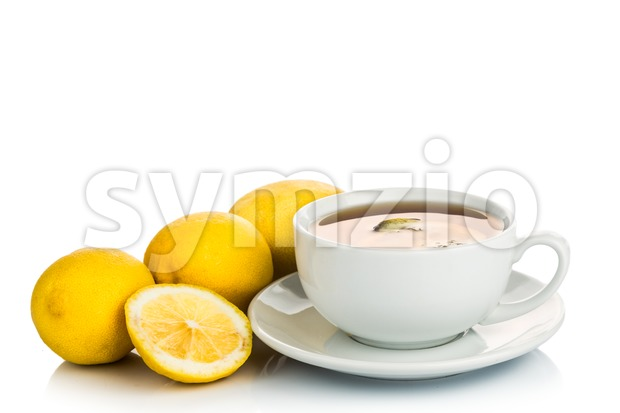 Refreshing hot tea with lemon slice on white background Stock Photo