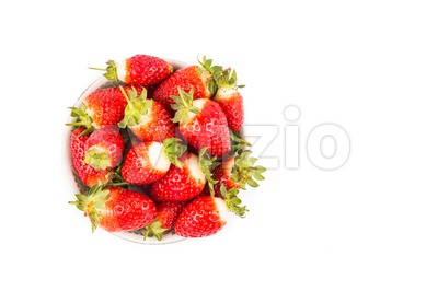 Plateful of freshly harvested organic strawberries with white background Stock Photo