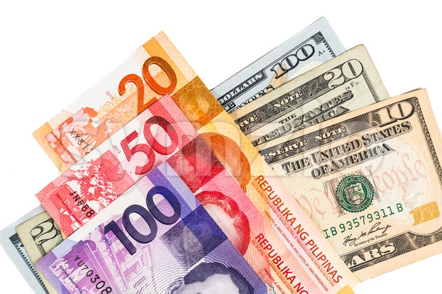 Close up of Philippines Piso currency note against US Dollar Stock Photo