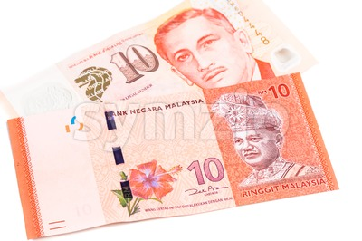 Close up of Singapore Dollar currency note against Malaysia Ringgit Stock Photo