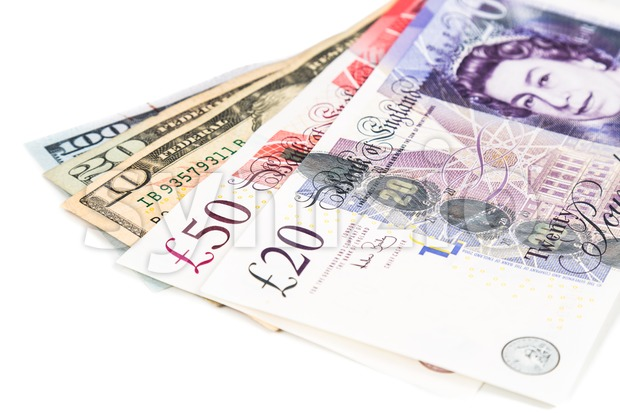 Close up of British Pound currency note against US Dollar Stock Photo