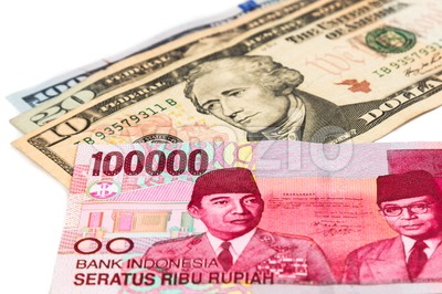 Close up of Indonesia Rupiah currency note against US Dollar Stock Photo