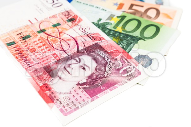Close up of British Pound Sterling note against EURO Stock Photo