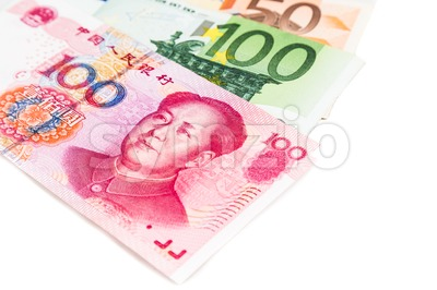 Close up of China Yuan Renminbi note against EURO Stock Photo