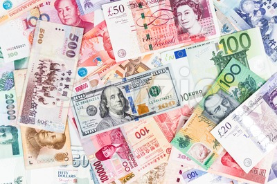 US Dollar with a pile of major currency note Stock Photo
