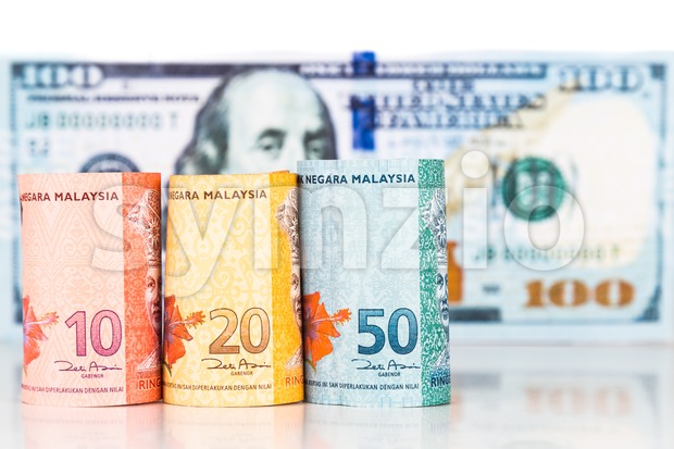 Close up of Malaysia Ringgit currency note against US Dollar Stock Photo