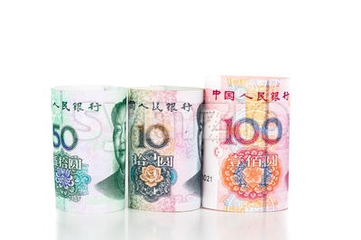 Close up of rolled up China Yuan Renminbi currency note Stock Photo