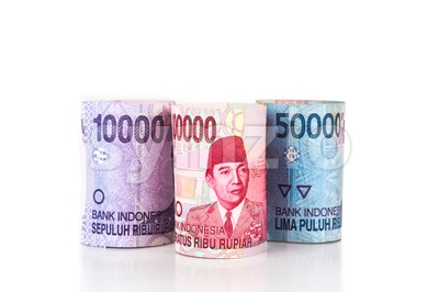 Close up of rolled up Indonesia Rupiah currency note Stock Photo