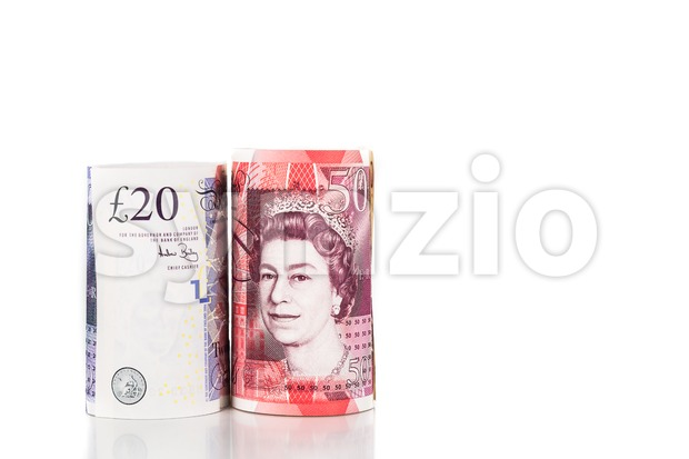 Close up of rolled up British Pound Sterling currency note Stock Photo