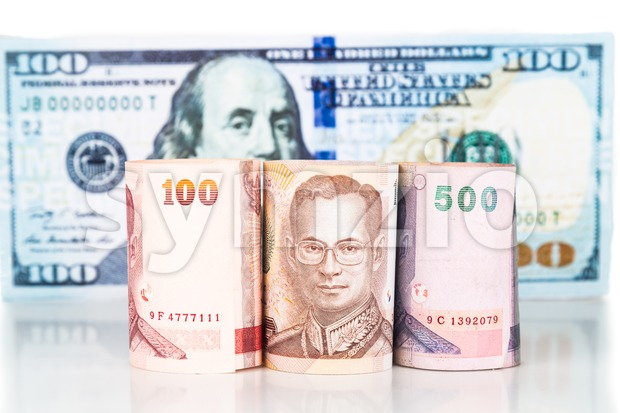 Close up of Thailand Baht currency note against US Dollar Stock Photo