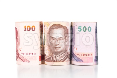 Close up of rolled up Thailand Baht currency note Stock Photo