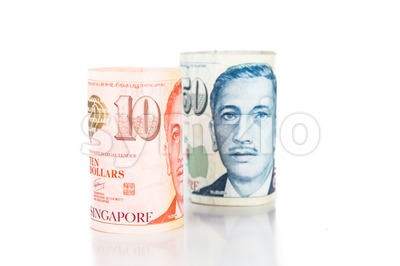 Close up of rolled up Singapore Dollar currency note Stock Photo