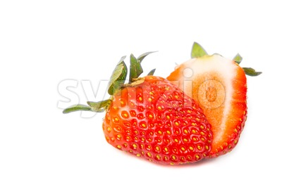 Closeup of sliced fresh juicy organic strawberries with white background Stock Photo