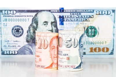 Close up of Singapore Dollar currency note against US Dollar Stock Photo