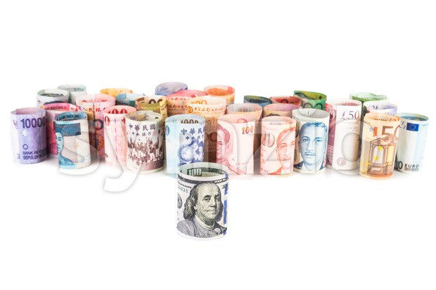 Pile of rolled-up currency notes with US Dollar in front Stock Photo