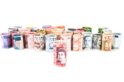 Pile of rolled-up currency notes with Sterling Pound in front Stock Photo