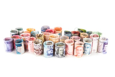 Pile of rolled-up currency notes Stock Photo