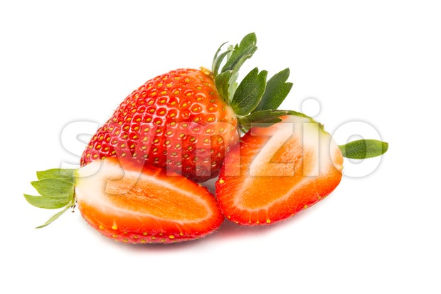 Closeup of fresh juicy organic strawberries with white background Stock Photo