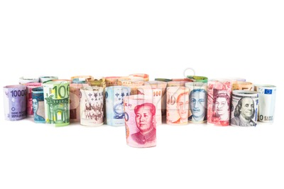 Pile of rolled-up currency notes with China Yuan Renminbi in front Stock Photo