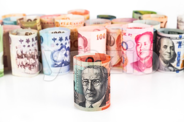Pile of rolled-up currency notes with Australian Dollar in front Stock Photo