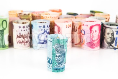 Pile of rolled-up currency notes with Malaysia Ringgit in front Stock Photo