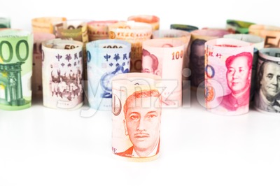 Pile of rolled-up currency notes with Singapore Dollar in front Stock Photo