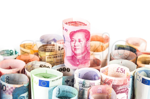 Pile of rolled-up currency notes with China Yuan Renminbi on top Stock Photo