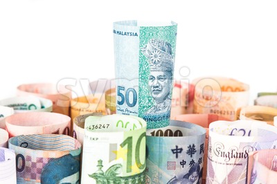 Pile of rolled-up currency notes with Malaysia Ringgit on top Stock Photo