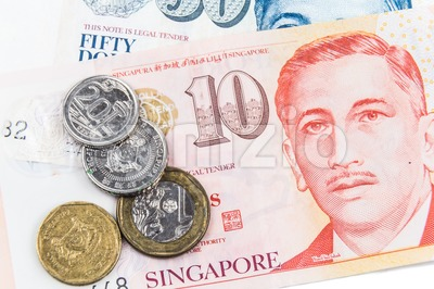 Close up on Singapore dollar currency notes and coins Stock Photo