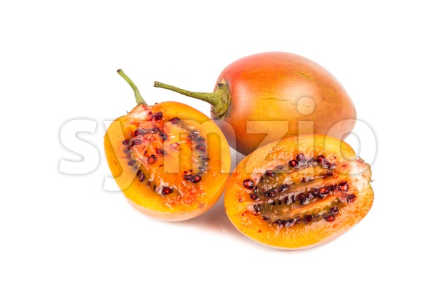 Sliced tamarillo fruits also known as tomato with white background Stock Photo