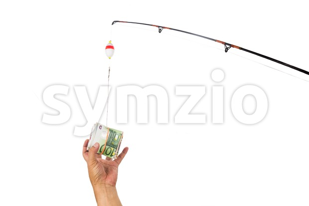 Concept of hand reaching for money casted as bait on fishing line Stock Photo