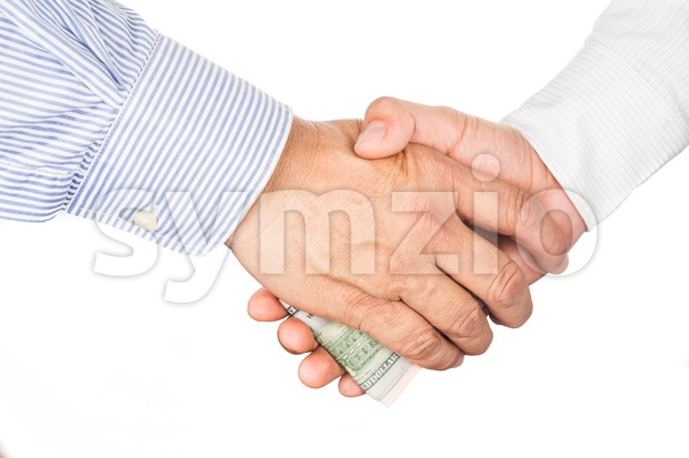 Hand shake deal with corrupt cash exchange Stock Photo