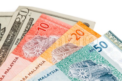 Closeup of Malaysia Ringgit and American US Dollar Stock Photo
