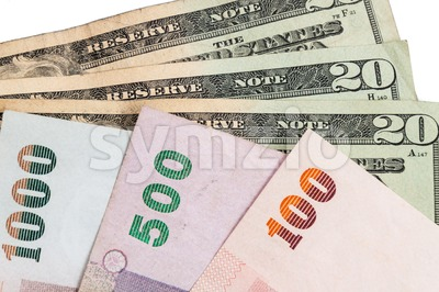 Closeup of Thai Baht and American US Dollar Stock Photo