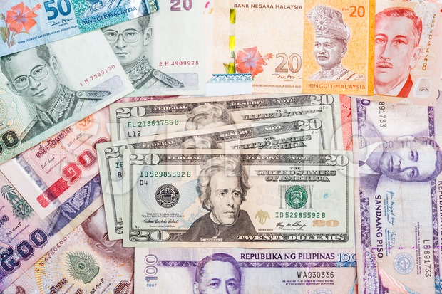 US Dollar with a pile of Asian currency note Stock Photo