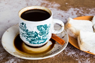 Traditional oriental Chinese coffee in vintage mug and hot buns served in coffee shop Stock Photo