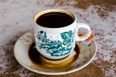 Traditional oriental Chinese coffee in vintage mug and saucer served in coffee shop Stock Photo