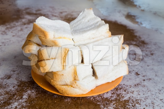 Traditional oriental steamed bread with butter and kaya at coffee shop Stock Photo