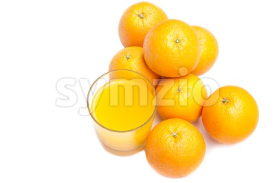 Fizzy orange juice from effervescent tablet with oranges at backdrop Stock Photo