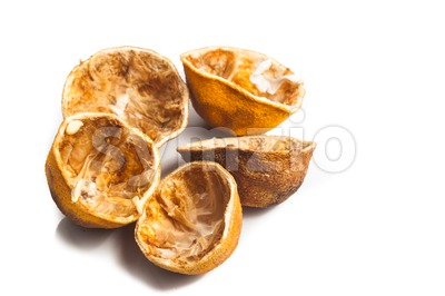 Dried lemon citrus peel in white background Stock Photo