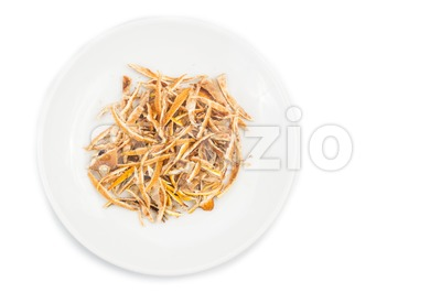 Dried lemon citrus peel on plate in white background Stock Photo