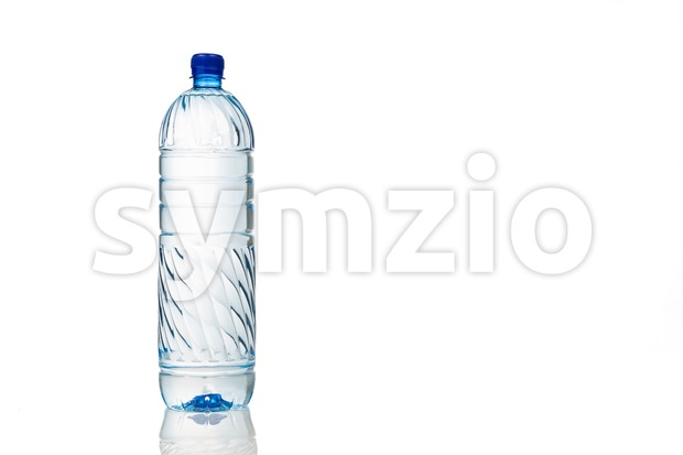 Single refreshing natural mineral water in plastic bottle in white background