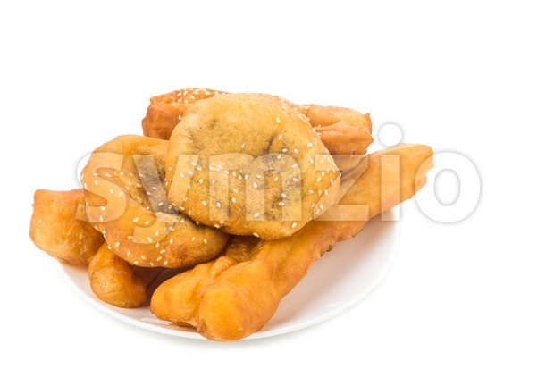 Combination serving of delicious you tiao, han chim peng and ma geok. Stock Photo